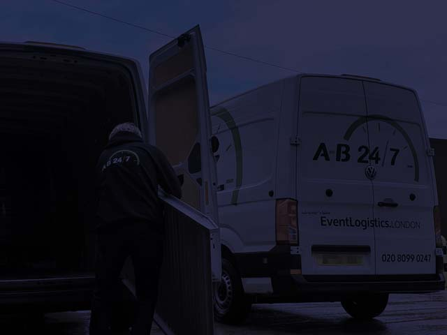 Night photograph or AB247 vans being loaded up