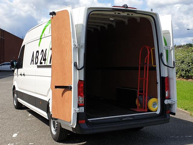 Photo showing rear of event van with doors open