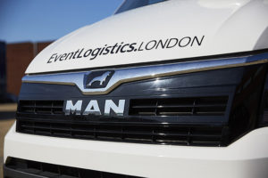 Photo of close up of MAN logo on event van grille