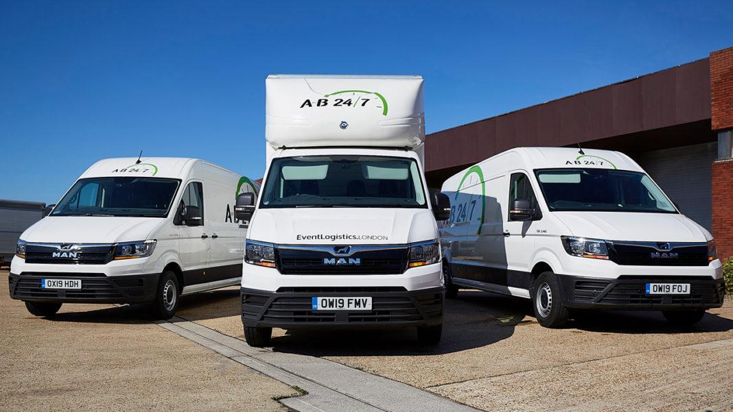 Photo of three event vans in carpark