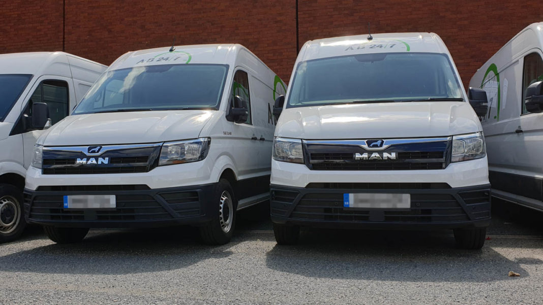 photo of a row of urgent delivery vans