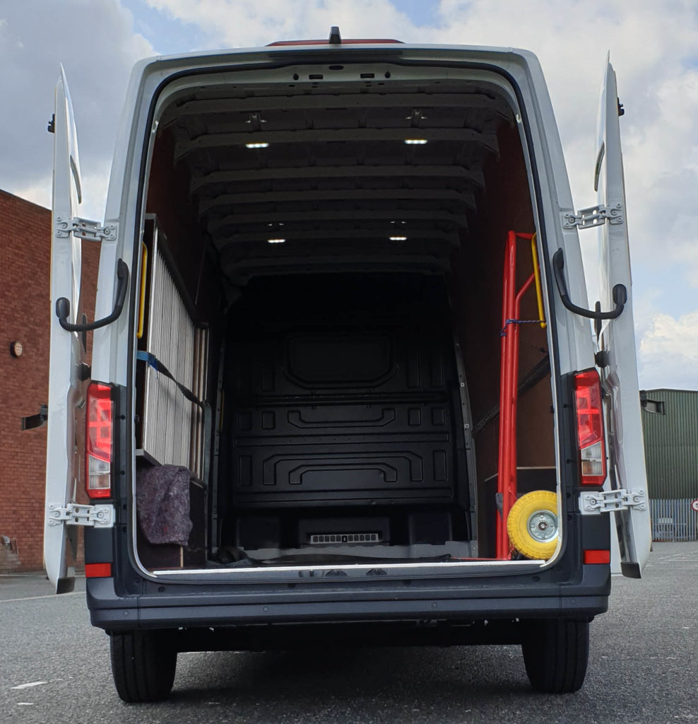 photo of urgent delivery vans with rear doors open
