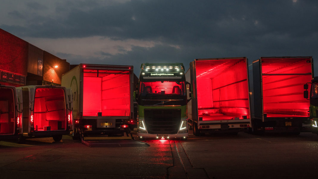 Empty A-D 24/7 Event trucks lit in red