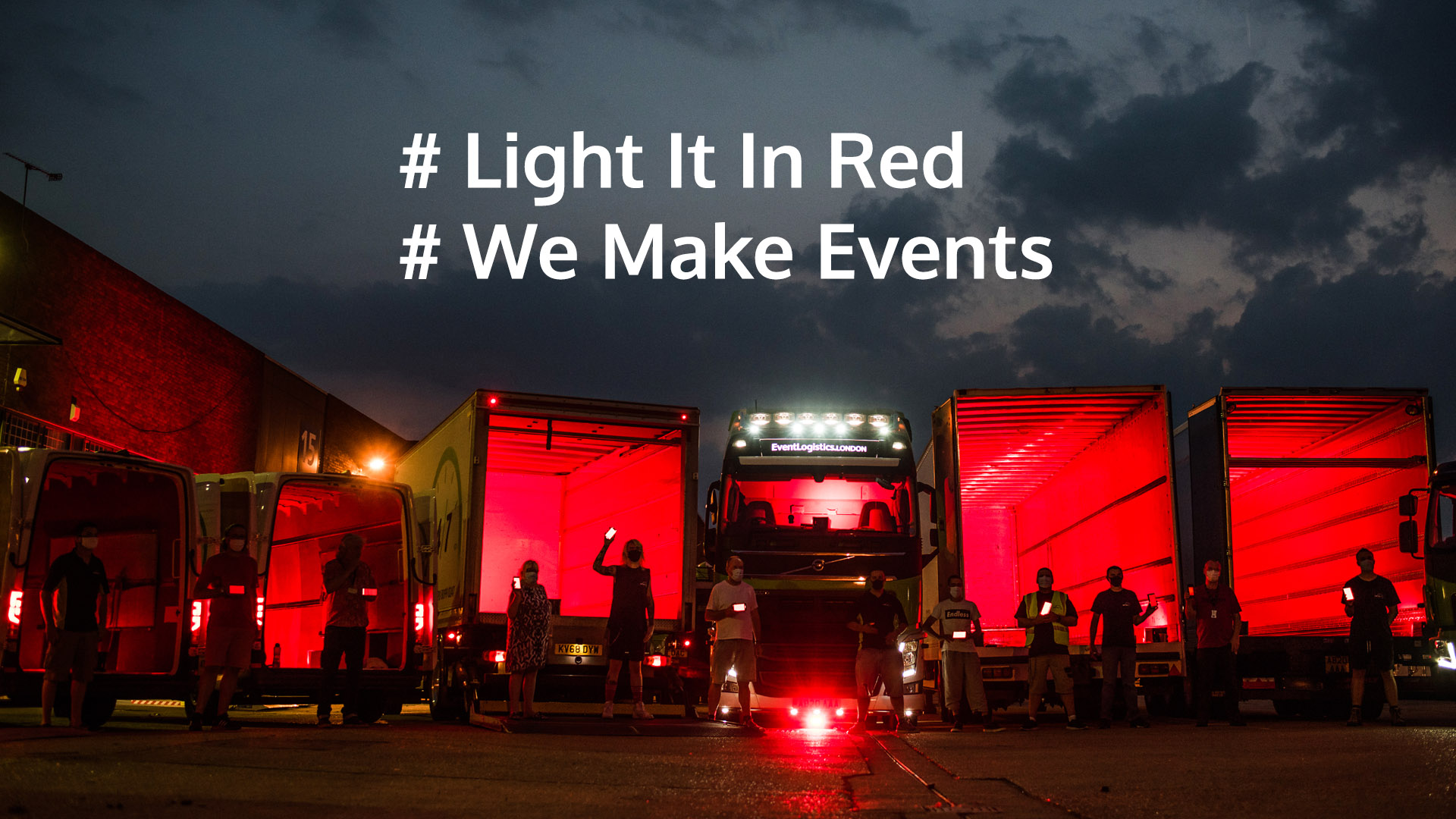 AB247 team in empty trucks for#lightitinred #wemakeevents